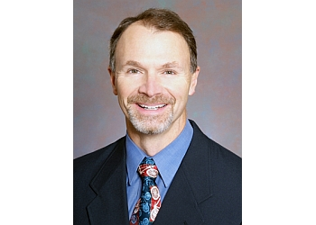 Spokane pain management doctor Dr. George M. Momany, MD