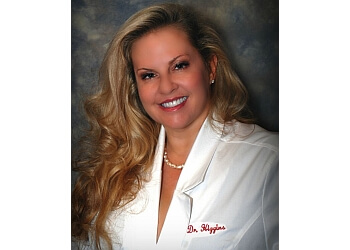 Lexington cosmetic dentist Dr. Gina L. Johnson-Higgins, DMD