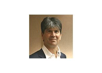 Lansing dermatologist Gregory G. Messenger, MD