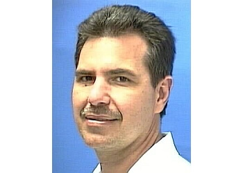 Hialeah gynecologist Dr. Hugo M. Ferrara, MD