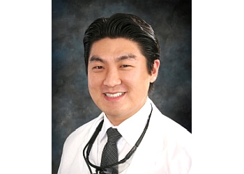 Fullerton dentist Dr. Hyung T. Kim, DDS, FICOI