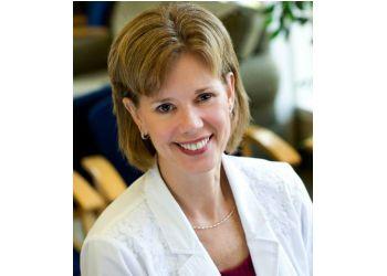 Evansville podiatrist Dr. JANE A. KOCH, DPM