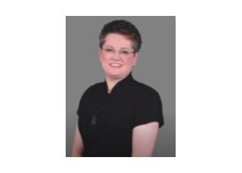 Syracuse dentist Dr. Janice Pliszczak, DDS, FAGD, MAGD