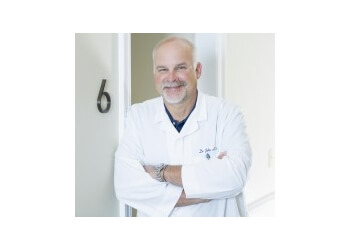Montgomery cosmetic dentist Dr. John A. Buettner