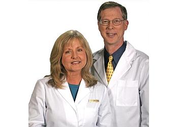Louisville cosmetic dentist Dr. John C. Kall, DMD, FAGD, MIAOMT