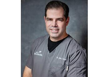 Orlando cosmetic dentist Dr. John E. Russo, DMD