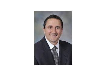 Manchester urologist John J. Munoz, MD