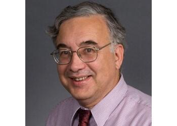Seattle neurologist JOHN W. MILLER, MD, PH.D