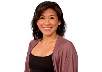 New York physical therapist DR. KARENA WU, PT, DPT, OCS, COMT, CSCS, CKTP. CPI