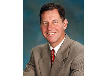 Dr. Kirby J. Plessala, MD