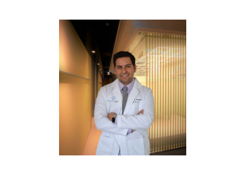 Washington cosmetic dentist Dr. Kourosh Ardekani, DDS