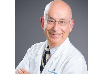 San Bernardino dermatologist  Dr. Leon E. Schwartz, MD