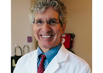 Lansing dentist Dr. Leslie N. Stumpos, DDS, PC