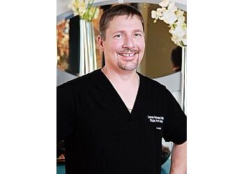 Gilbert cosmetic dentist Dr. Lonnie C. Eckman, DMD