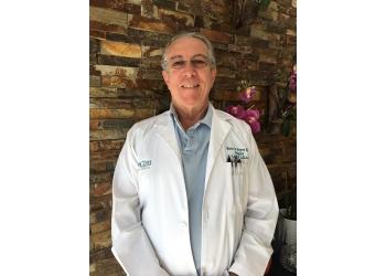 Hialeah plastic surgeon Dr. Mario E. Reyes Serrano, MD