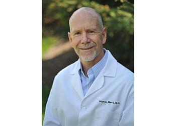 Lansing dermatologist Mark E. Hatch, DO