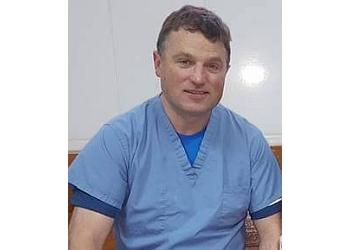 Dr. Mark E. Keller, DDS