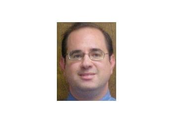 Denver neurologist Dr. Mik K. Stambuk, MA, MD