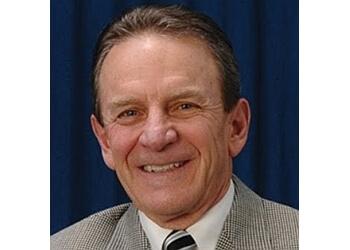Lansing dermatologist Mitchell A. Rinek, MD