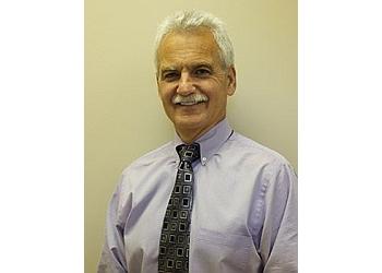 Louisville dentist Dr.Patrick Carroll, B.A, D.D.M