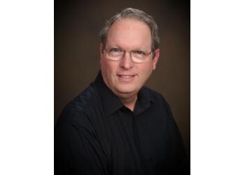 Pasadena cosmetic dentist Dr. Paul B. Covell, DDS