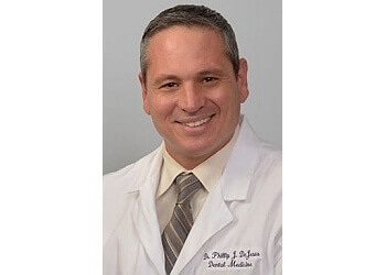 Bridgeport cosmetic dentist Dr. Phillip J. DeJesus, DDS, MAGD, FICIOI
