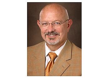 Lubbock pain management doctor Dr. Ralph G. Menard, MD