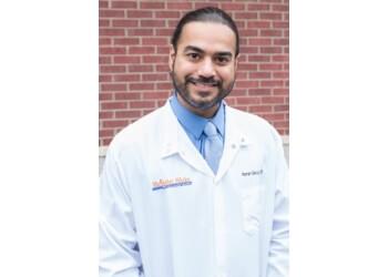 Warren dentist Dr. Raman Saluja, DDS