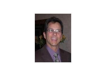 Grand Prairie gynecologist Reynold J. DiLena, MD