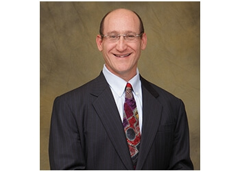 Milwaukee cosmetic dentist Dr. Richard B. Winter, DDS, MAGD, DICOI, DAB, OI/ID, FAAID