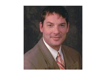 Wichita pain management doctor Robert J. Ain, MD