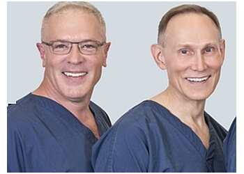 Cary dermatologist Dr. Robert E. Clark, MD, PhD & Dr. Timothy C. Flynn, MD
