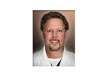 Denver pain management doctor Rock Navarkal, MD, JD
