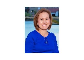 Corona dentist Dr. Rowena Layson, DMD