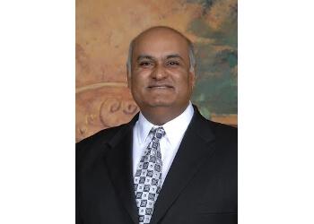 Dr. S.M. Bhatt, DDS