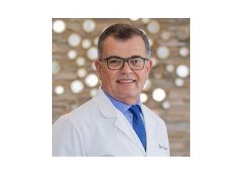 Columbus cosmetic dentist Dr. Sam M. Latif, DMD, FMII, FICOI, DICOI