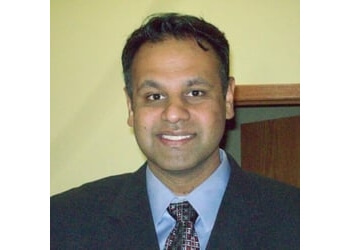 Joliet cosmetic dentist Dr. Sunil Kurup, DDS