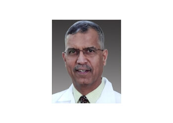 Dr.  Suresh Govindram Gurbani, MD