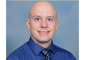 Cedar Rapids eye doctor Dr. Taylor Neumann, OD