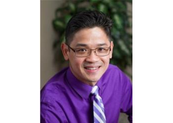 Tacoma dentist Dr. Thai Nguyen, DDS, IBO, AFAAID, FADI, FPFA