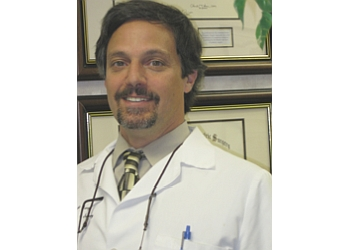Aurora podiatrist Dr. Thomas J. Savage, DPM