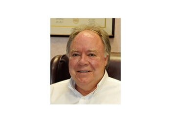 Raleigh dermatologist Dr. Thomas R. Andrus Jr., MD