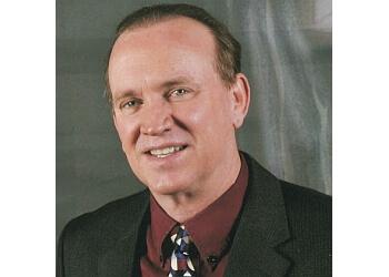 Peoria dermatologist Dr. Vernon T. Mackey, DO