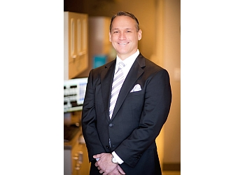 Kansas City cosmetic dentist Dr. William C. Busch, DMD, MAGD