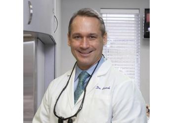 Kansas City cosmetic dentist Dr. William C. Busch, DMD, MAGD
