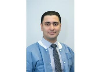 Bridgeport dentist Yulian Aminov, DDS - DOWNTOWN DENTAL