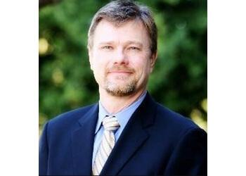San Bernardino plastic surgeon Duncan Miles, MD, FRCSC