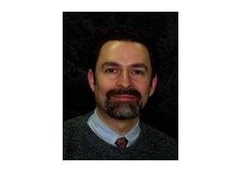 Akron dermatologist Eliot N. Mostow, MD