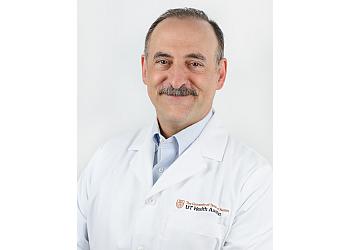 Dallas neurologist Elliot M. Frohman, MD