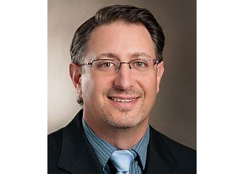 Charlotte orthopedic Eric B Laxer, MD